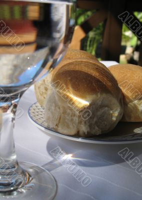 plate of bread on a lunch table