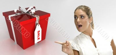surprised blonde woman pointing to gift