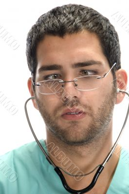 doctor with stethoscope in his ears looking squint