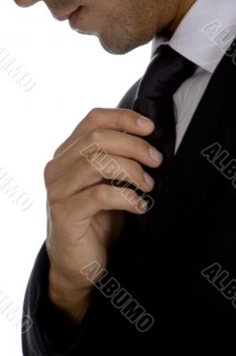 well dressed businessman adjusting his tie