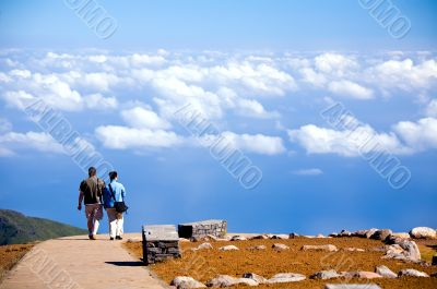 Couple going on road to blue sky in Madeira Island