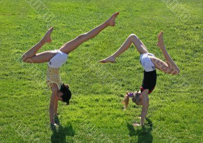 Two girls exercising