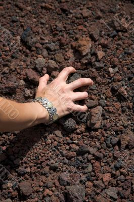 woman take volcanic stones