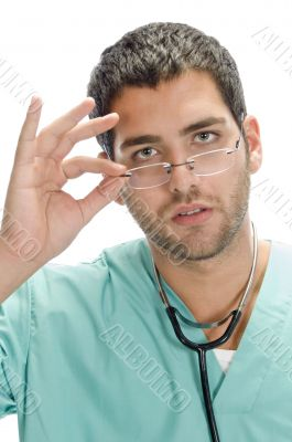 doctor holding spectacles