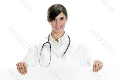 lady doctor standing with placard
