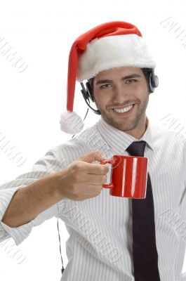 young man enjoying coffee and wearing santa cap