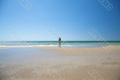 lonely woman at the beach