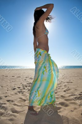 woman dancing with beach wrap