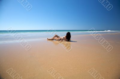 woman lie down at seaside