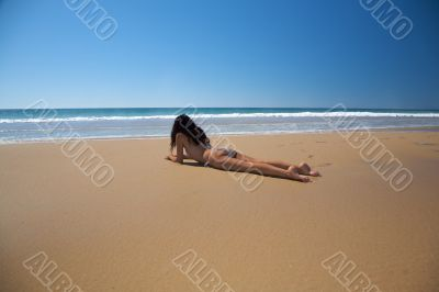 bikini woman lie down on the sand