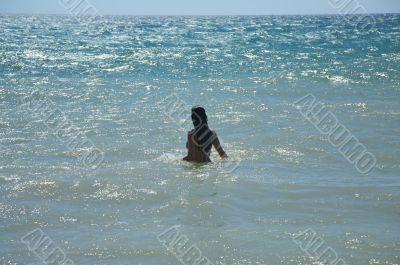 woman in a brilliant sea