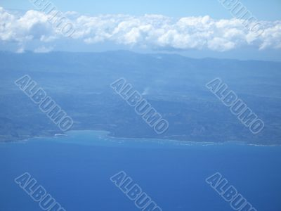 ocean and land viewed from a plane