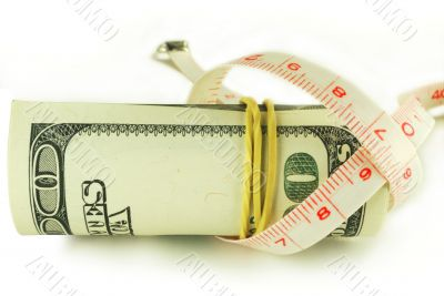 One hundred dollar bill roll - dollar grows thin