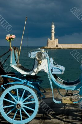 Blue traditional carriage with flowers and lighthouse