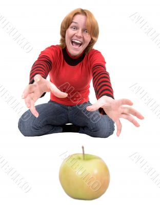 Woman stretch a hand to apple