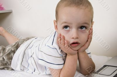 child in thinking pose