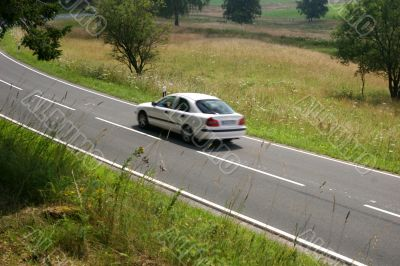 Car on the move at a country road