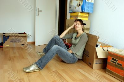 Tired young woman by  a move