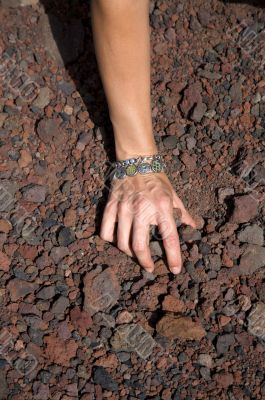 woman hand pick up stones