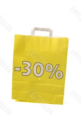 yellow shopping bag with 30 % discount