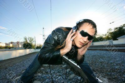 DJ listening to the rails