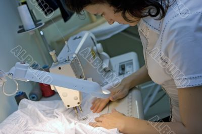 Working on a sewing machine