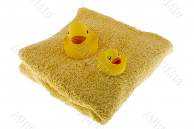 rubber duck sits on towel