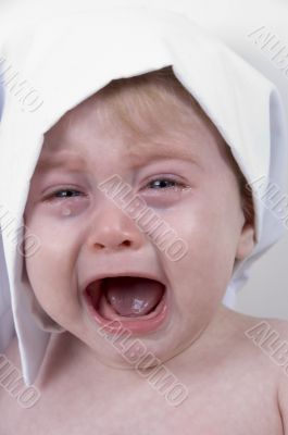 weeping cute baby with chef cap and pot