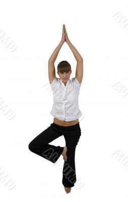 woman doing yoga on one leg