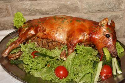 Roasted whole pig