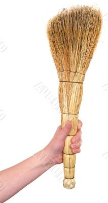 Old dirty broom in hand