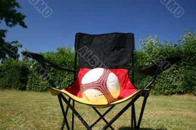 ball on a german flagged chair
