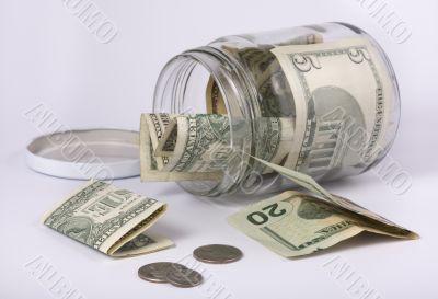 an open glass jar with money