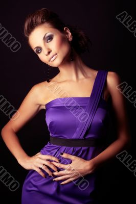 beautiful and sexy brunette fashion girl in violet dress