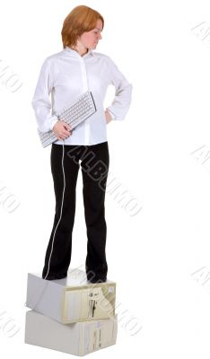 Girl standing on two computers