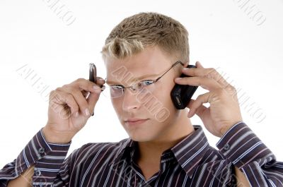 serious businessman communicating on cell phone