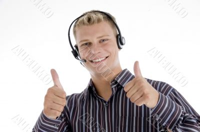 executive communicating and showing thumbs up