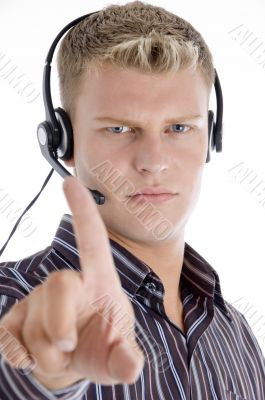 male with headset showing his index finger