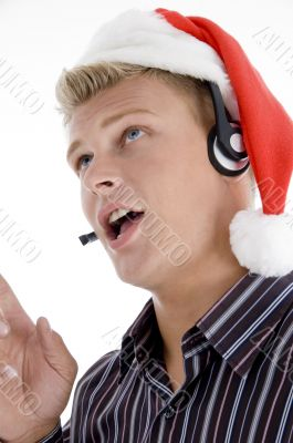 american man wearing headphone and santa hat