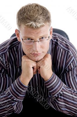 smart businessman with his chin resting his fists