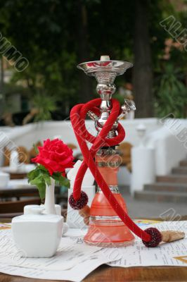 Hookah and red rose in vase