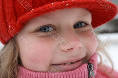 Smiling child in red hat