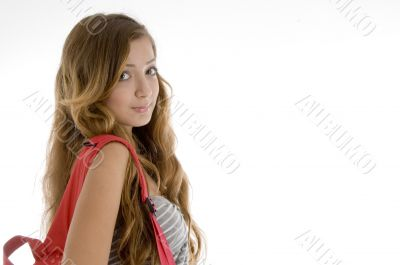 beautiful girl with bookbag on her shoulder