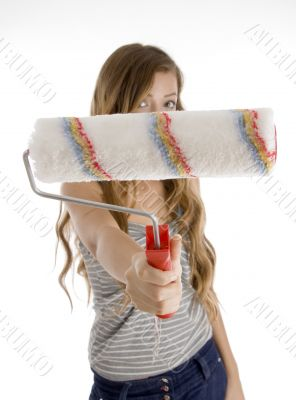 cute teen girl showing painting brush