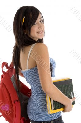 teenager student with books and bookbag