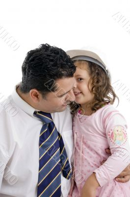 daughter whispering in his father`s ear