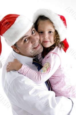 father and cute daughter with christmas hat