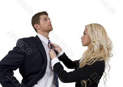 lady knotting tie of man