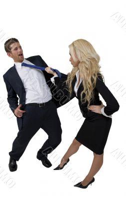 female pulling tie of man