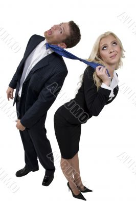 female pulling tie of businessman
